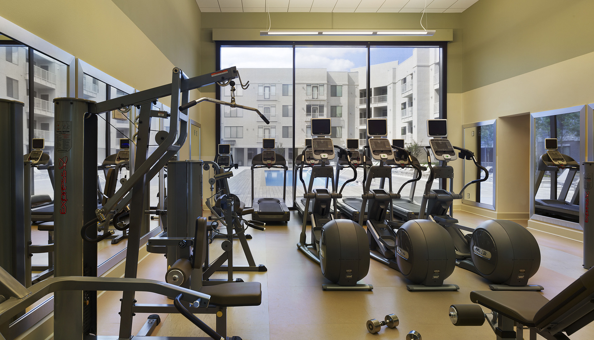 AVE Clifton fitness center with pool view