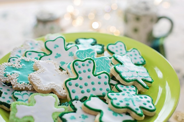 Shamrock cookies on a green plate