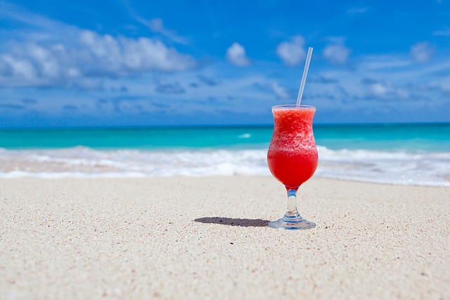 Red frozen cocktail on beach