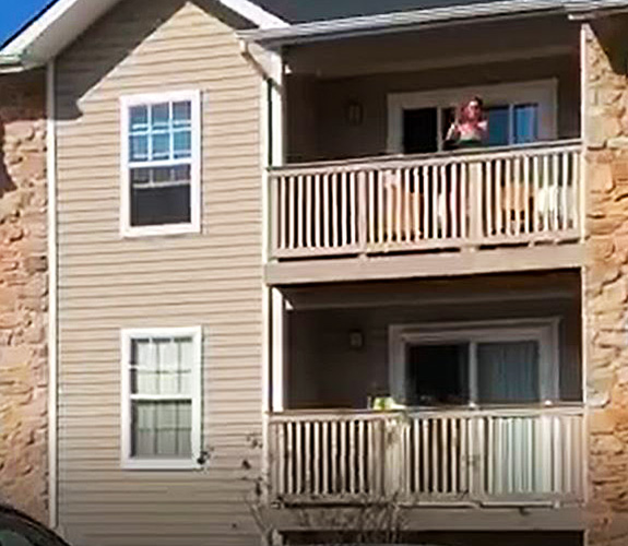 Malvern Resident on Balcony cheering on First Responders